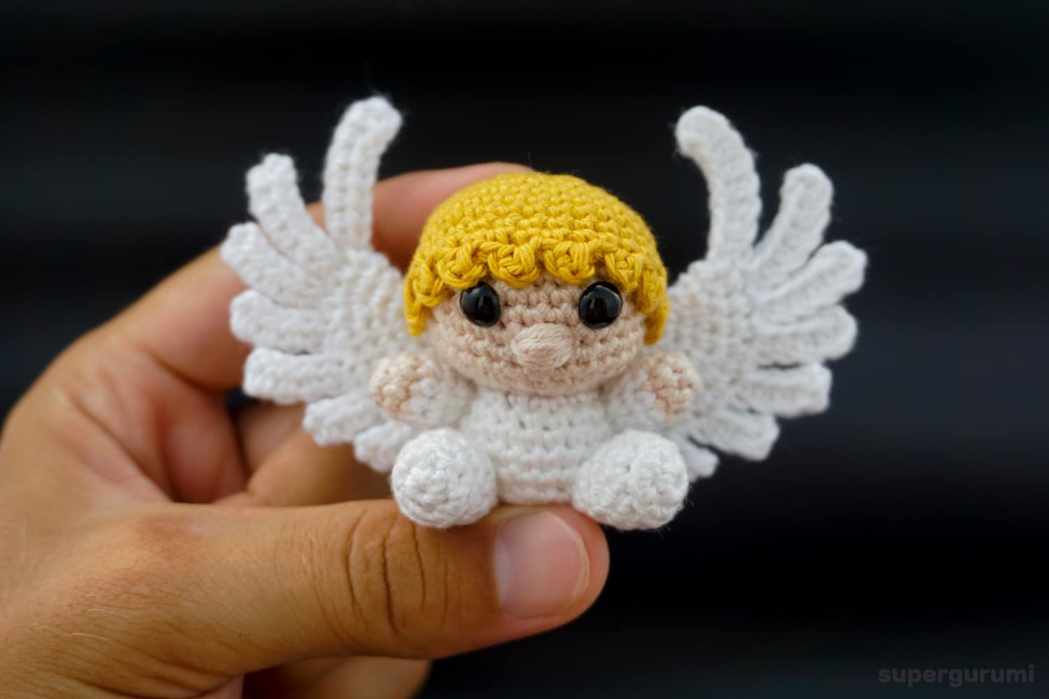 Amigurumi crochet angel pattern supergurumi the depicted amigurumi angel is crocheted using a 25 mm crochet hook and the schachenmayr catania cotton and has sitting a height of 7 cm and a wingspan dt1010fo